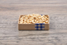 Oats on wood Stock Images