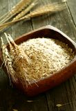 Oats in wooden bowl on wooden Royalty Free Stock Photo