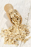 Oats on a wooden shovel Royalty Free Stock Images