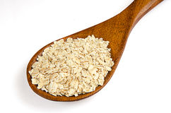 Oats with wooden spoon Stock Photography
