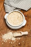 Oats with a wooden spoon. On a table royalty free stock photo