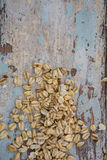 Oats on wooden surface Stock Photo