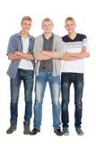 Oavkortad tillväxt för högväxta unga grabbar royaltyfria foton