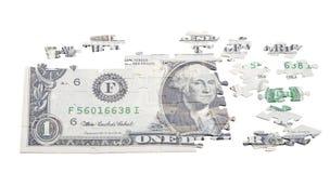 Oavslutat pussel från en dollar som isoleras på vit royaltyfria foton