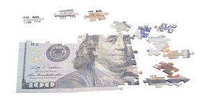 Oavslutat pussel från hundra dollar som isoleras på vit arkivbild