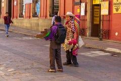 Souvenir sellers on street, Oaxaca, Mexico. In Oaxaca historic quarter, work days begin early for souvenir sellers royalty free stock photos