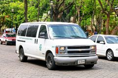 Chevrolet Express. Oaxaca, Mexico - May 25, 2017: Passenger van Chevrolet Express in the city street royalty free stock photo