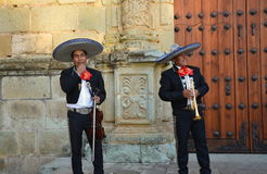 Oaxaca, Mexico-November 3, 2016: Mariachi singers take a break from singing to joke around Royalty Free Stock Photography