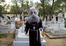 Oaxaca, Mexico-November 1, 2016: A mascot stands in the Oaxacan cemetery for the Day of the Dead celebrations Stock Images