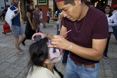 Oaxaca, Mexico-November 1, 2016: A woman gets her makeup done for day of the dead Royalty Free Stock Images