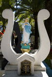 Oaxaca, Mexico-October 31, 2016- Grave marker in a cemetery with the Virgin Mary Stock Images