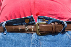 Obésité - dernier trou de courroie Photographie stock libre de droits