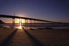 The OB Pier at sunset. The sun sets behind the pier at Ocean Beach, California Stock Photo