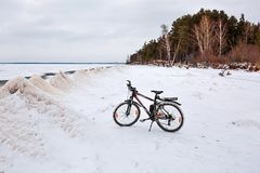 Winter landscape with a Bicycle on the frozen river. The Ob Rive Stock Photography