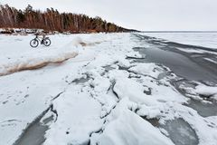 Winter landscape with a Bicycle on the frozen river. The Ob Rive Royalty Free Stock Photo