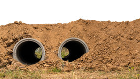 Oba betonowe drymby zakopują w ziemi zdjęcia royalty free