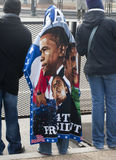 Obama Blanket. A supporter attending the inauguration of Barack Obama, first African American President of the United States, keeps warm in a souvenir blanket Stock Image