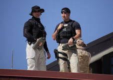 Obama campaign roof security team. Roof Security on the top of a building where President Obama was speaking in Reno. They didn't want this 400mm picture taken Royalty Free Stock Photos
