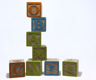Obama Care Blocks. Childs toy blocks spelling Obama Care on white background Stock Image