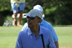 Obama playing golf Hawaii. President Obama playing golf during christmas 2013 in Hawaii Stock Photo