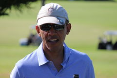 Obama playing golf Hawaii Royalty Free Stock Image