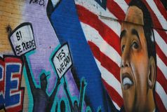 Obama and political context of the graffiti. A photo of graffiti made on the street of New York City presenting face of Obama and people screeming YES, WE CAN royalty free stock images