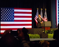 Obama speaks in Front of Flag at the Rally Stock Images