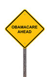 ObamaCare Ahead - Caution Sign. Isolated On White Stock Photography