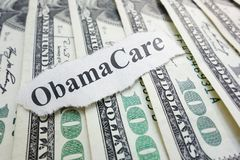 Obamacare. Closeup of an Obamacare newspaper headline on cash Stock Photo