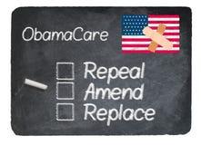 Obamacare concept using chalk on slate blackboard Stock Photos