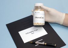 ObamaCare Prescription. Bottle with Affordable Care Act folder Royalty Free Stock Image