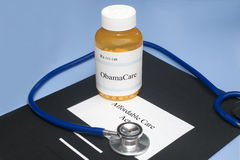 ObamaCare Prescription. Bottle with Affordable Care Act folder and stethoscope Royalty Free Stock Image