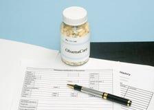 ObamaCare Prescription. Bottle with insurance verification form Royalty Free Stock Image