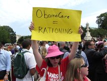 Obamacare Rationing. Photo of woman against obamacare at the supreme court in washington dc on 6/28/12.  Rationing is one of the possible problems with the Stock Images