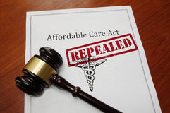 Obamacare repeal concept. Affordable Care Act aka ObamaCare policy with Repealed stamp and gavel Royalty Free Stock Photography
