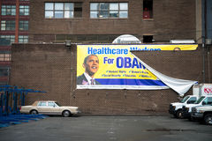 Obamacare. Torn poster for Obamacare on a wall in Manhattan Royalty Free Stock Images