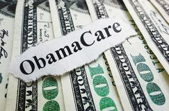 Obamacaregeld royalty-vrije stock foto
