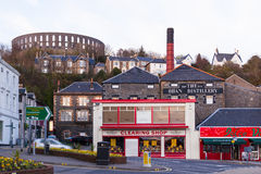 The Oban Distillery and the Coliseum. McCaig's Tower is a prominent tower on the hillside overlooking Oban in Argyll, Scotland stock images