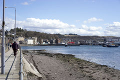 Oban Harbor. The islands Western Scotland in the Atlantic are known as The Hebrides. Oban harbor has ferries that travel between the mainland of Scotland and 22 Royalty Free Stock Image