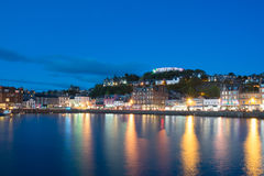 Oban in Highland at night, Autumn season in Scotland. The night lighting of Oban in Highland at night with reflection of the sea, Autumn season in Scotland Royalty Free Stock Image