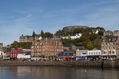 Oban Scotland UK. UK SCOTLAND Oban -- View of the seafront in Oban with McCaigs folly visible in the upper centre of the the image -- Picture by Jonathan Royalty Free Stock Photography