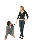 Obedience. A man on all fours and a young woman pulling him by a necktie Stock Photo