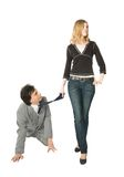 Obedience. A man on all fours and a young woman pulling him by a necktie Stock Image