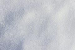 Obefläckad snöbakgrund vit texturerar Arkivbild
