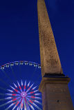Obelisk and big wheel in Paris Royalty Free Stock Photography