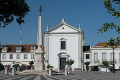 Obelisk and church in the city center. The center of Vila Real de Santo António was inspired by downtown Lisbon, the geometric design of its cobblestone Royalty Free Stock Photography