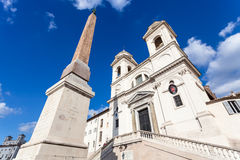Obelisk and church Trinita dei Monti in Rome city. Travel to Italy - obelisk Obelisco Sallustiano and church of the Santissima Trinita dei Monti in Rome city Royalty Free Stock Photo