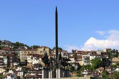 Obelisk and horsemen Stock Photo