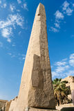 Obelisk in Karnak Temple. Big obelisk with carving figures and hieroglyphs in landmark Egyptian Karnak Temple, public ancient monument declared a World Heritage stock images