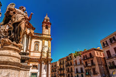 The obelisk-like Colonna dell Immacolata in the square San Domenico in Palermo, Sicily, Italy. The obelisk-like Colonna dell Immacolata, Immaculate Virgin with Royalty Free Stock Images